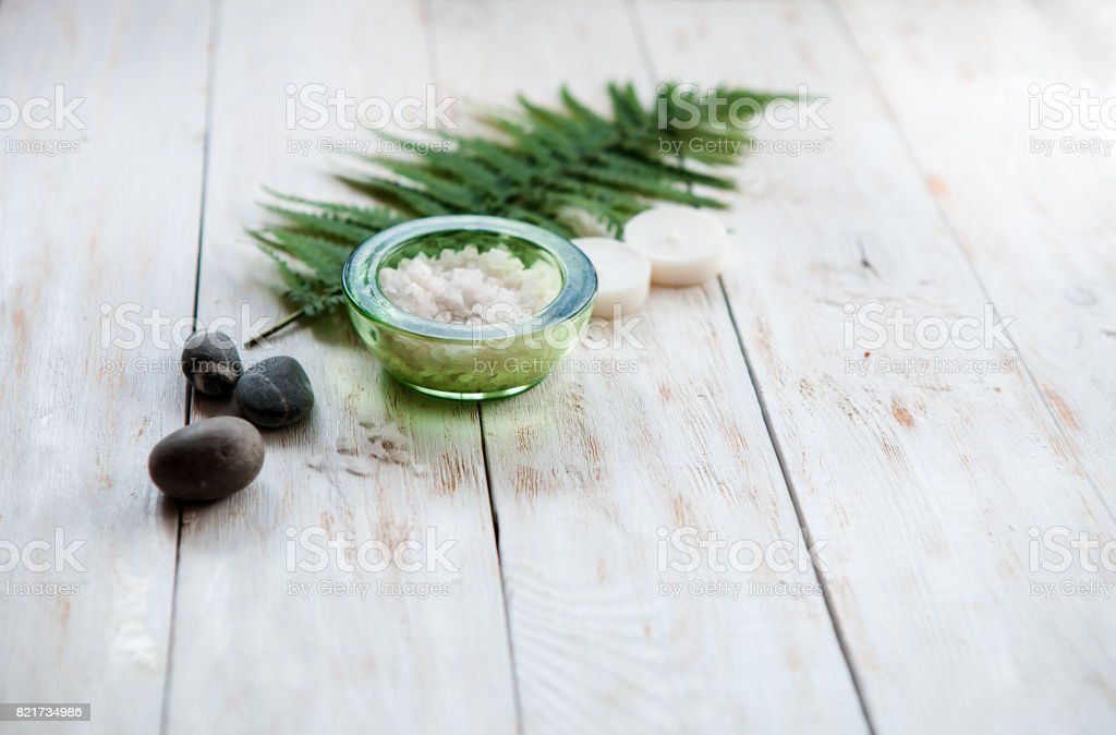 Spa concept, spa background, stylized photo, top view, with a space for a text ,flat lay sea salt, lotion, candles stock photo