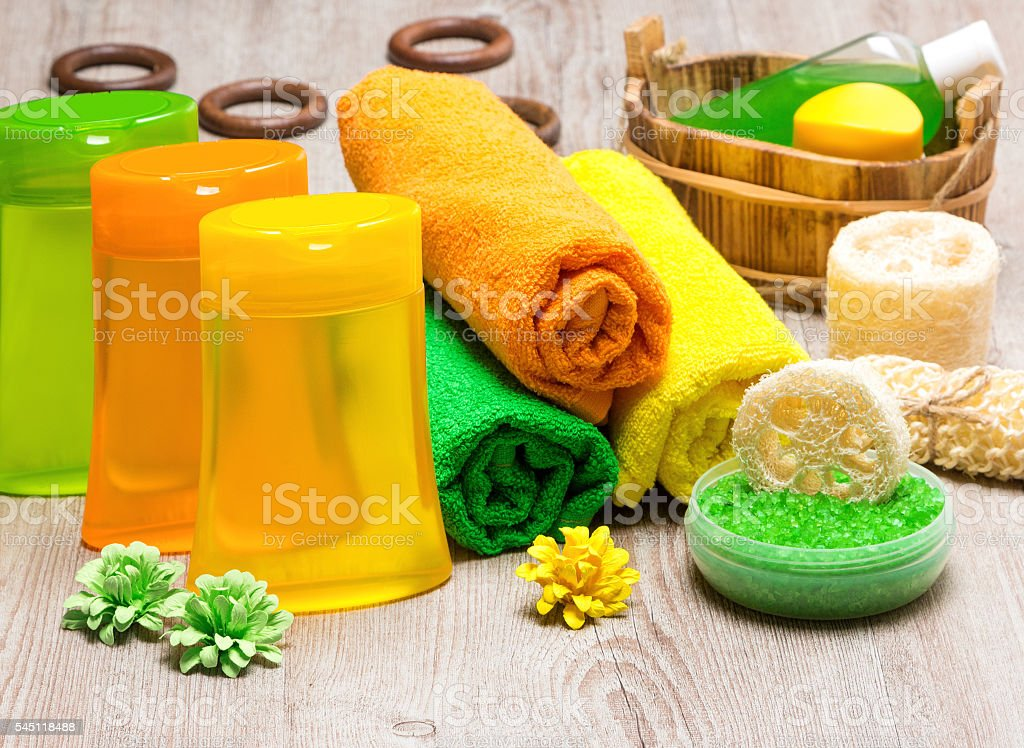 Spa cosmetics and accessories on shabby wooden surface stock photo