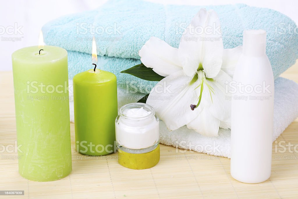 Spa decoration.  Towels, candles and cream. royalty-free stock photo