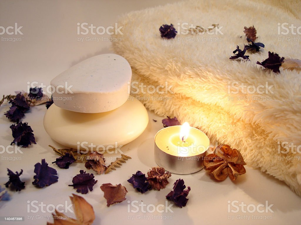 Spa essentials (soap, candle and towel with flowers) royalty-free stock photo