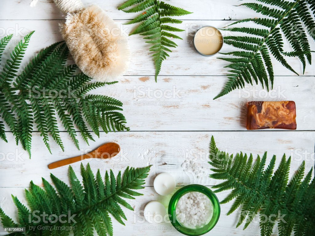 Spa floral background, flat lay of various beauty care products decorated with simple white flowers, space for your text stock photo