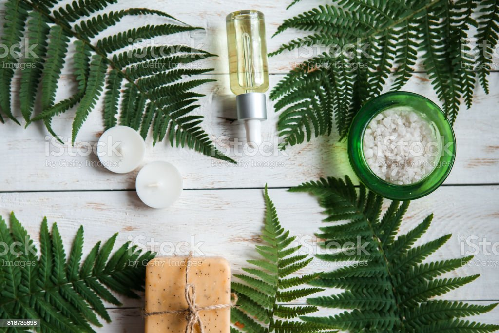 Spa floral background, flat lay of various beauty care products decorated with Fern. stock photo