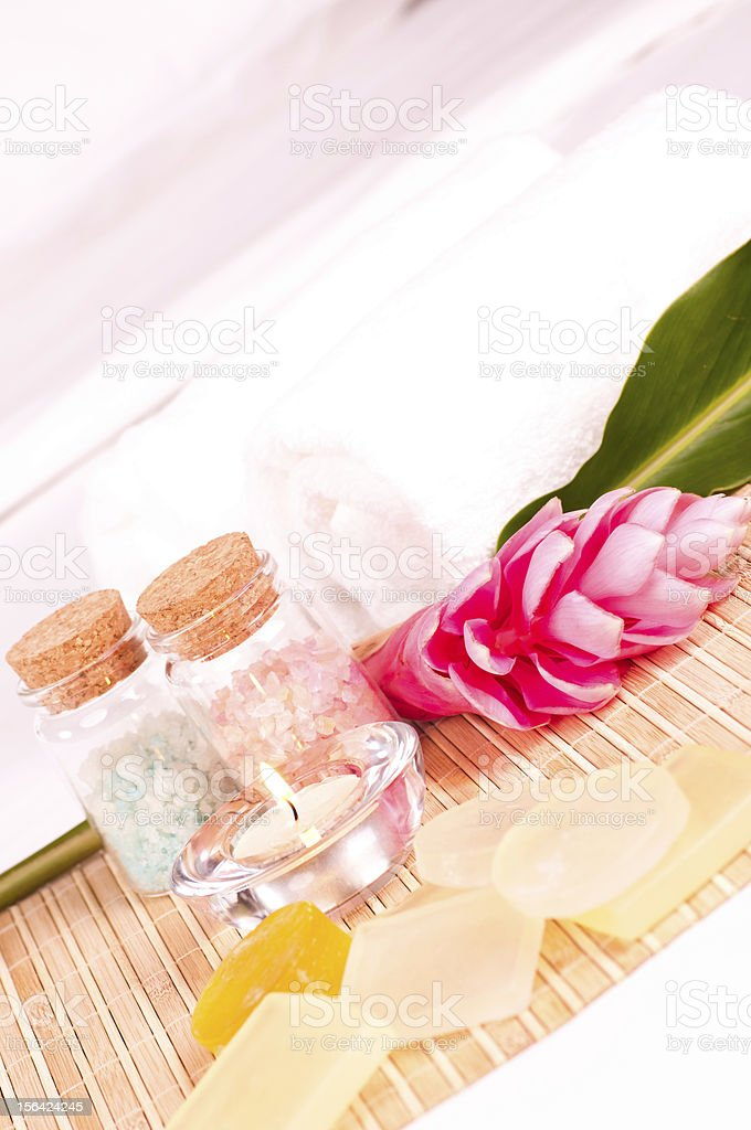 Spa getaway with pink ginger flower and soaps royalty-free stock photo