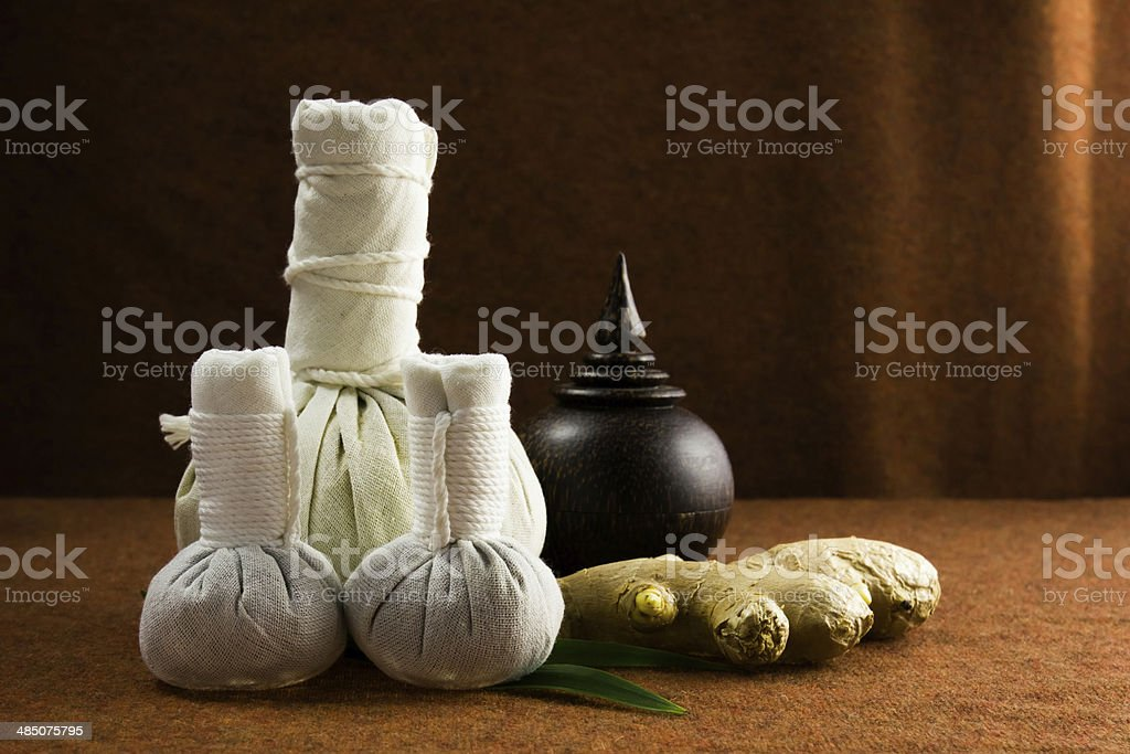 Spa herbal compressing ball with herbs and casket stock photo