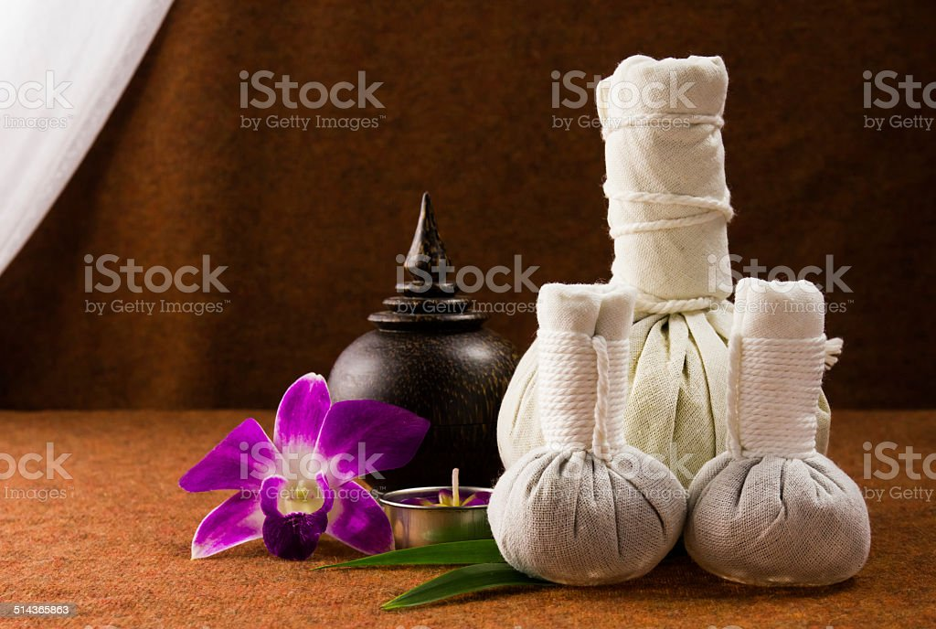 Spa herbal compressing ball with wooden casket and orchid. stock photo