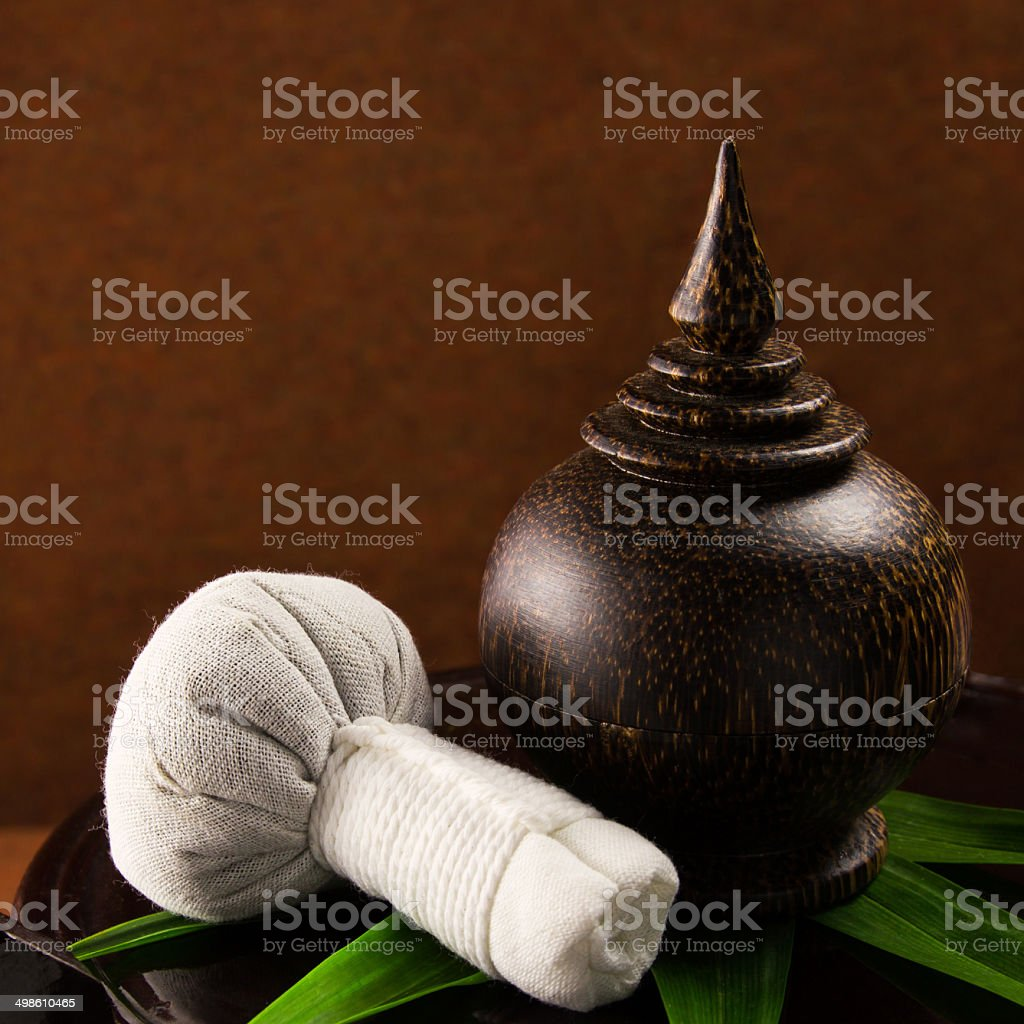 Spa herbal compressing ball with wooden casket. royalty-free stock photo