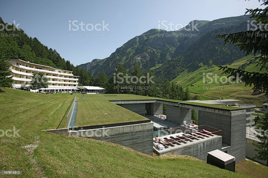 Spa hotel and swimmingpool in the swiss mountains at summer royalty-free stock photo