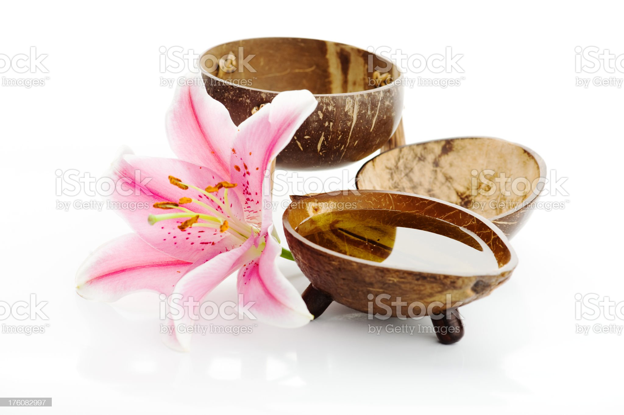 Spa items - bowls with massageoil and a pink lilly royalty-free stock photo