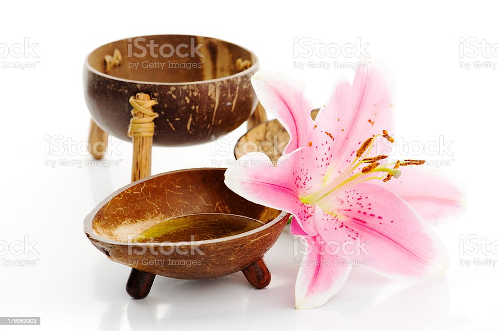 Spa items - bowls with massageoil and a pink lilly stock photo