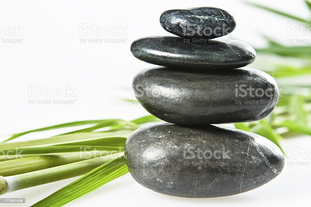 spa lastone therapy pebbles stack isolated on white stock photo