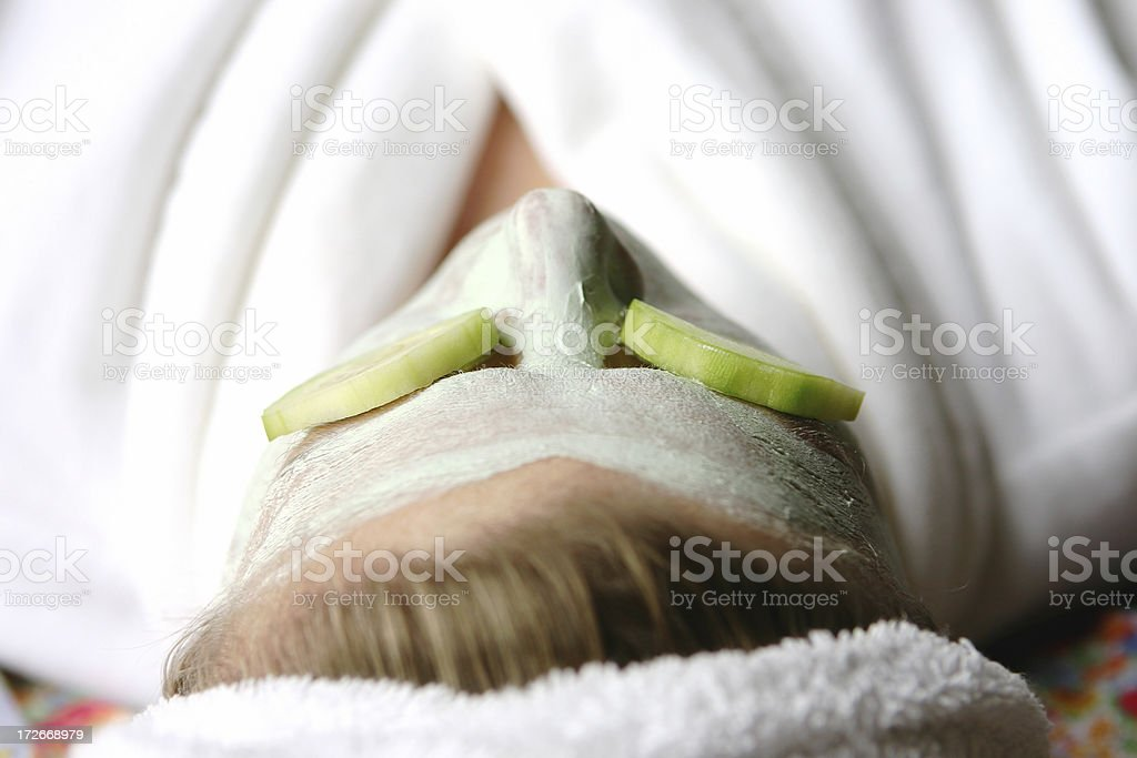 Spa Mask with Cucumbers royalty-free stock photo