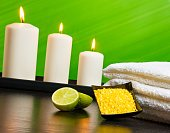 spa massage border background with towel stacked sea salt candles