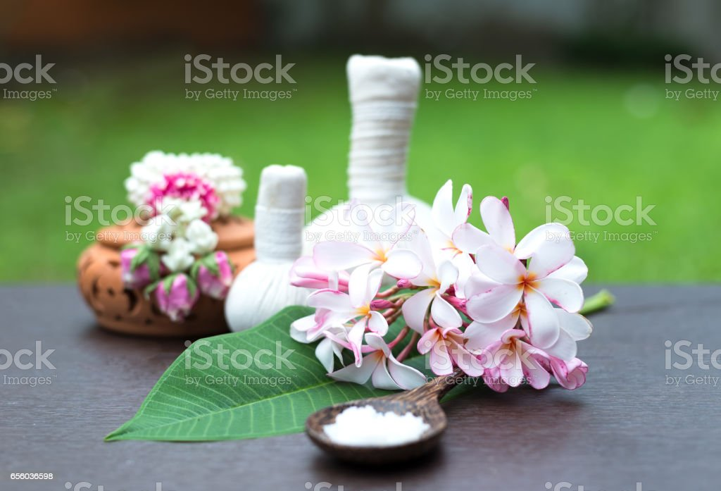 Spa massage compress balls, herbal ball and treatment  spa, Thailand, select focus flower stock photo