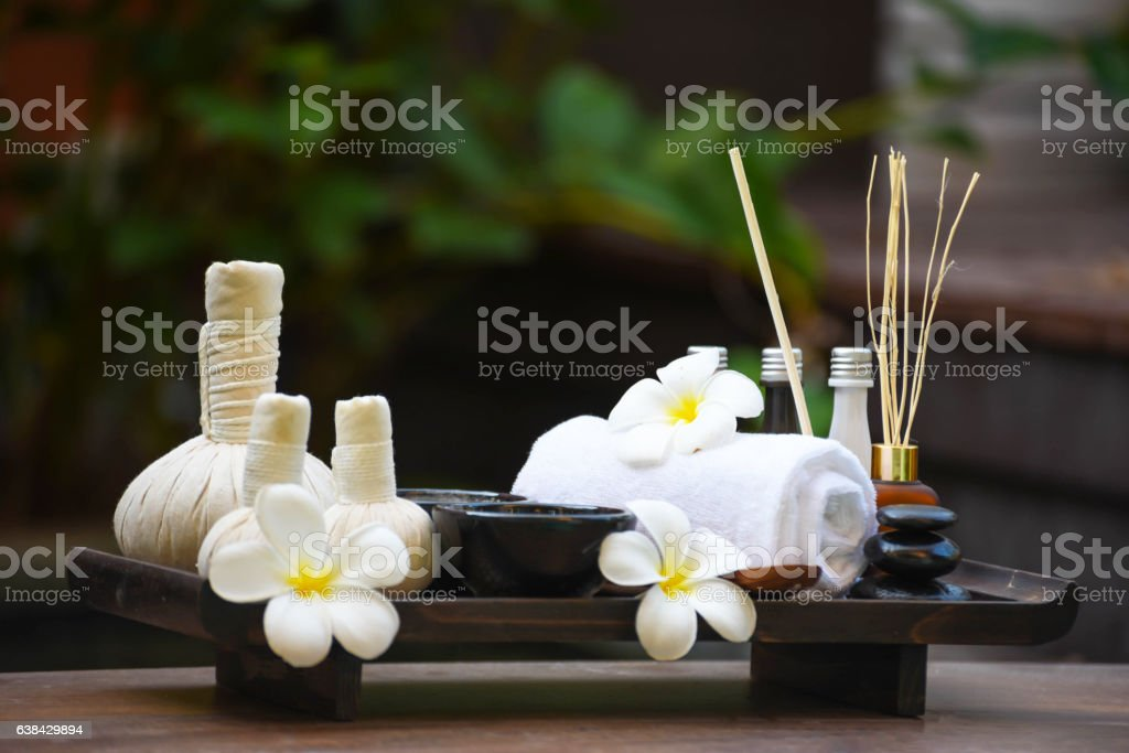 Spa massage compress balls, herbal ball on the wooden. stock photo