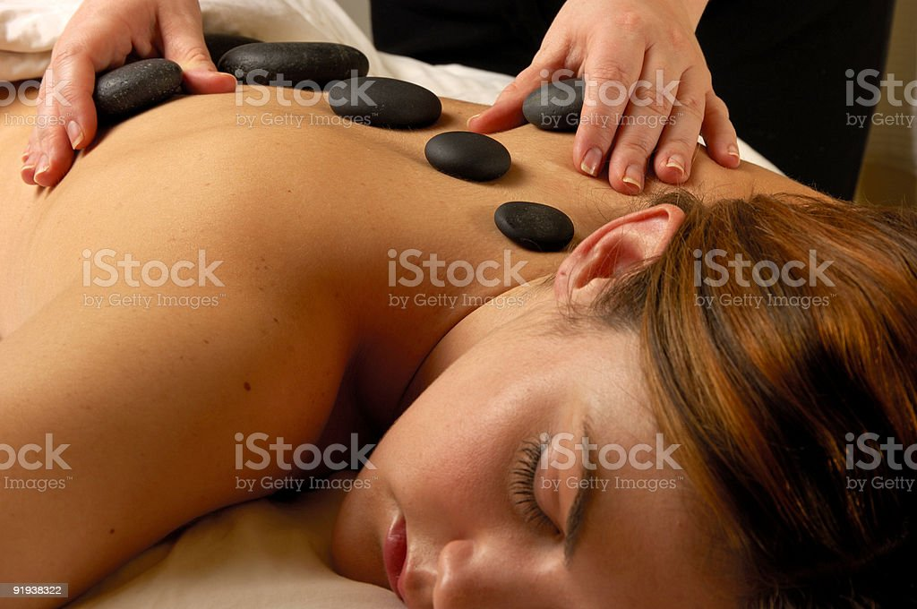 Spa Massage Hot Mineral Stone Treatment stock photo