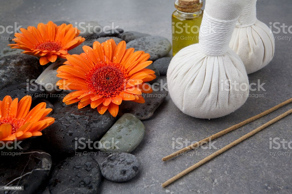 Spa massage setting with rolled towel, thai herbal compress balls stock photo