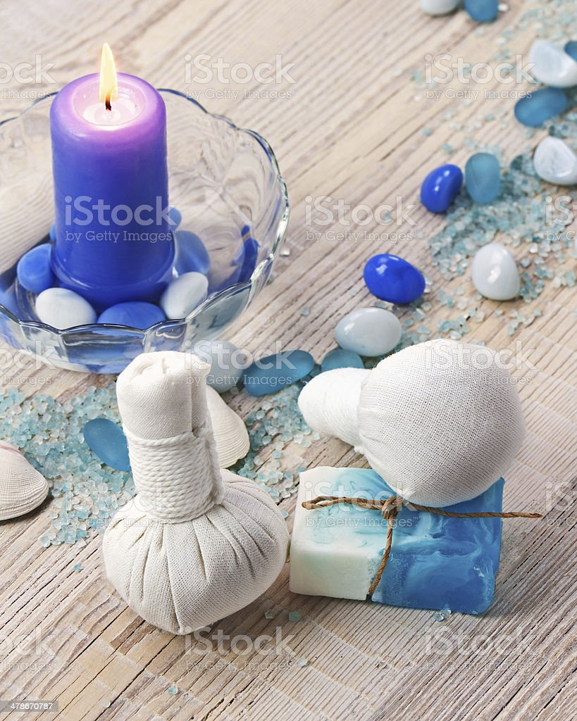 Spa massage setting with thai herbal compress stamps. royalty-free stock photo