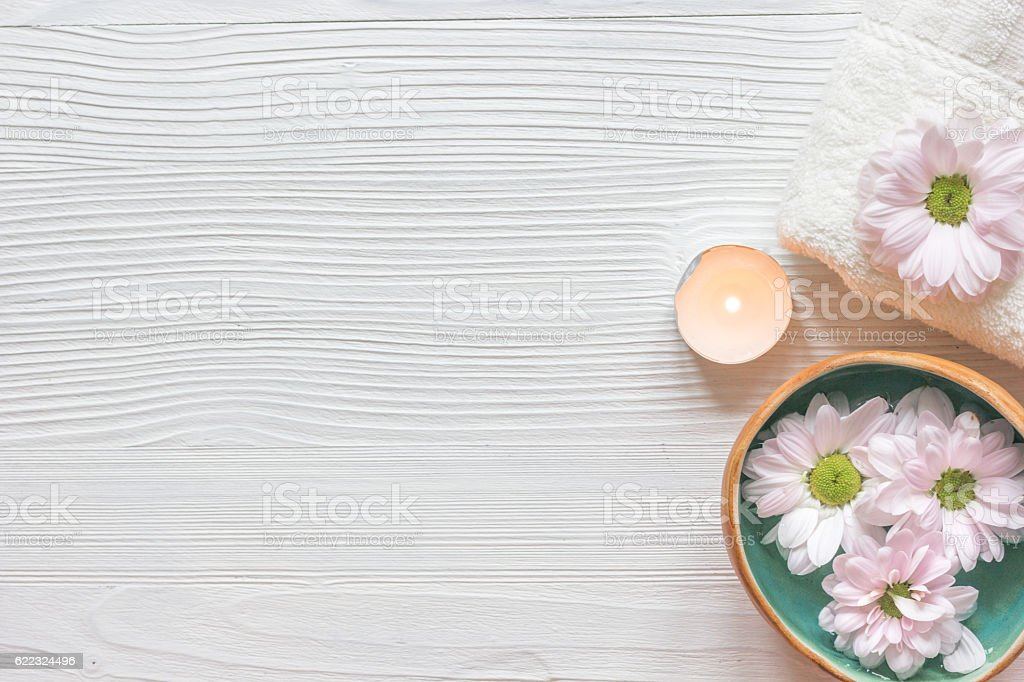 spa nail care with tea candle wooden background top view stock photo