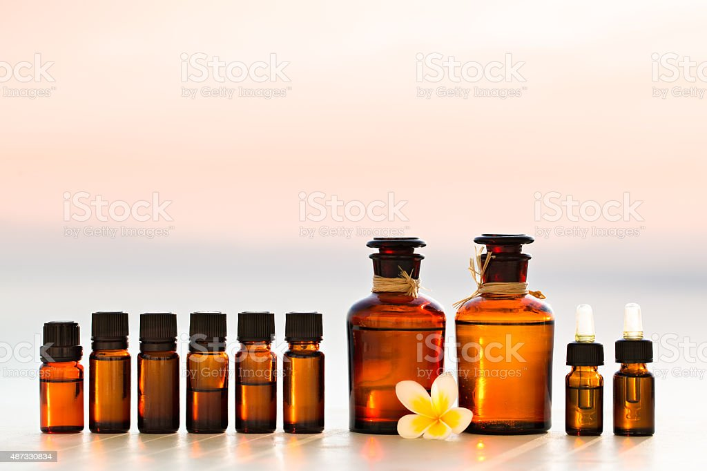 Spa oils in bottles on sunset stock photo