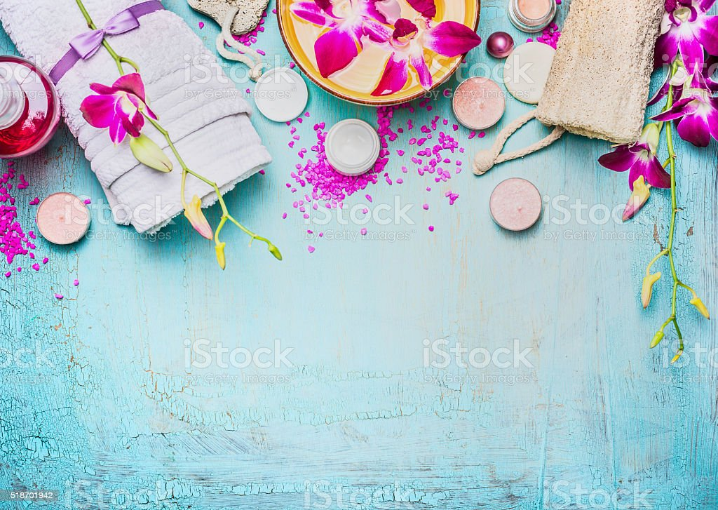 Spa or wellness setting with pink purple orchid flowers stock photo