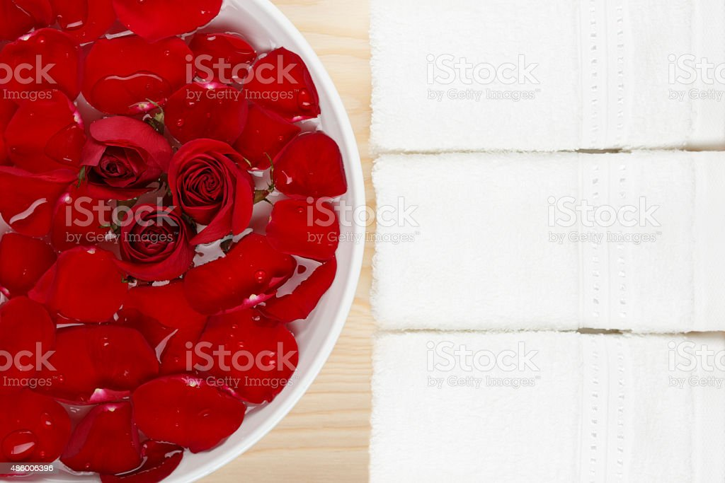 Spa Pedicure Manicure Massage Set with Red Roses Wood Background royalty-free stock photo