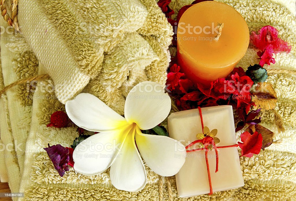 Spa products with flowers and candle royalty-free stock photo