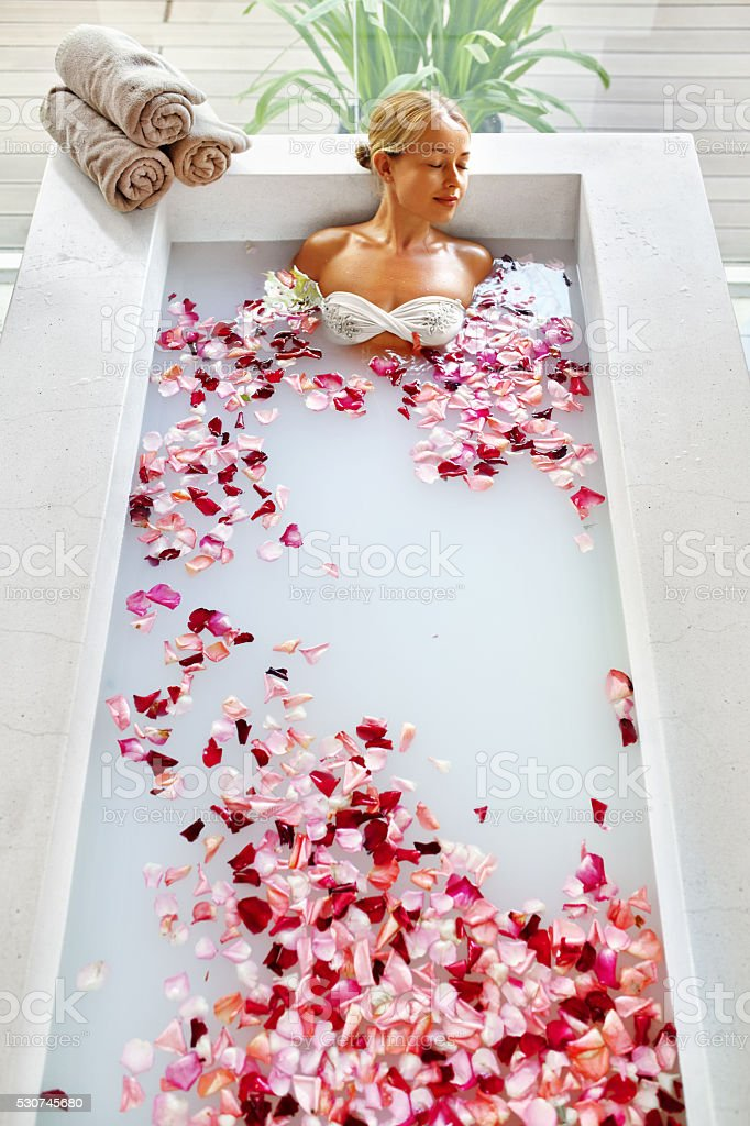 Spa Relaxation. Woman Body Care. Flower Bath. Beauty Skincare stock photo