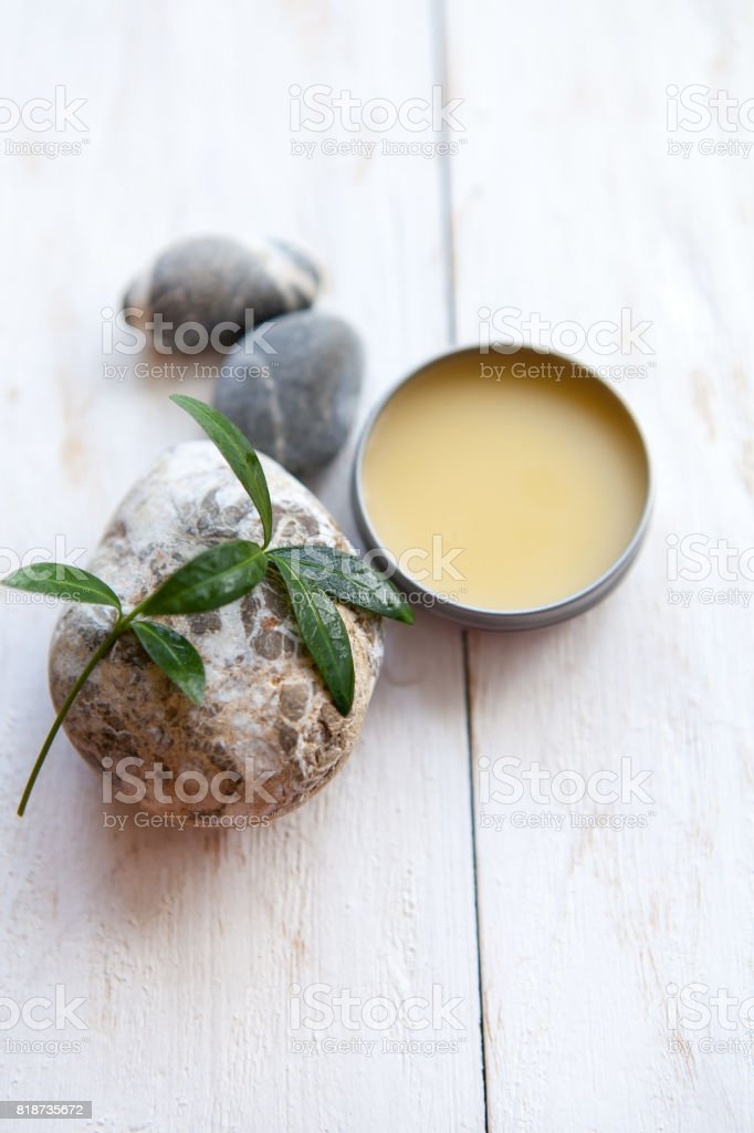 Spa resort and wellness composition. beauty cream with Fern on white wooden background.flat lay stock photo
