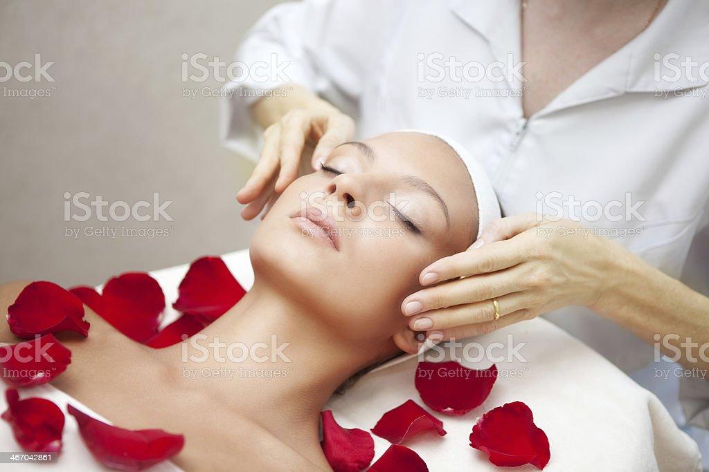 Spa salon: Young Beautiful Woman Having Facial Massage royalty-free stock photo