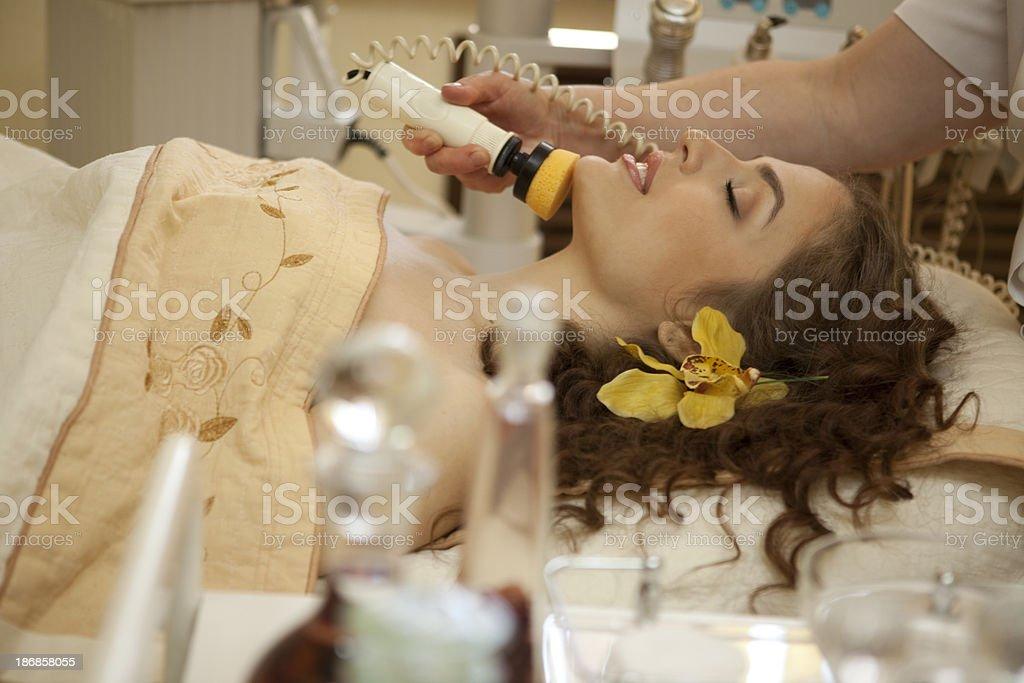 Spa salon: young beautiful woman having facial treatment.XXXL royalty-free stock photo