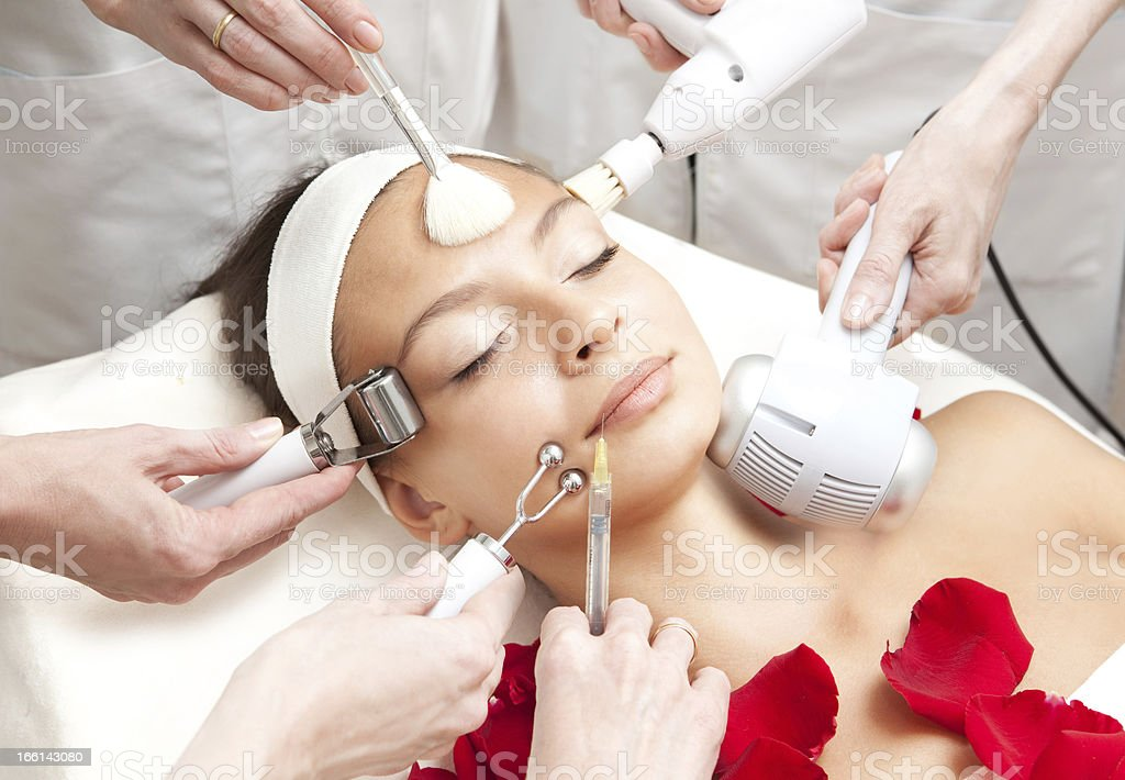 Spa Salon: Young Beautiful Woman Having Various Facial Treatment royalty-free stock photo