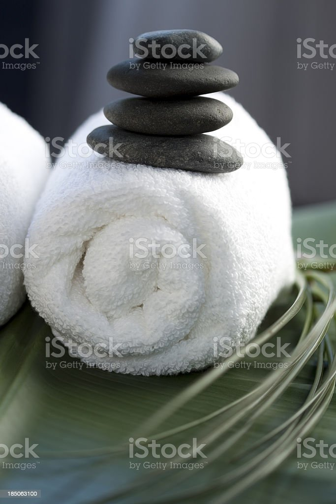 Spa scene with balanced massage stones royalty-free stock photo