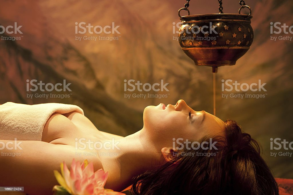 Spa Series: Young Beautiful Woman Having  Shirodhara stock photo