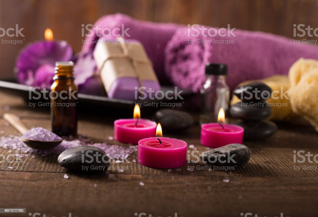 spa setting on wooden surface stock photo