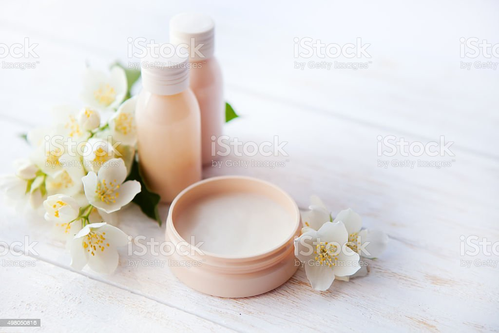 Spa setting with beauty cream and white  jasmine flower stock photo