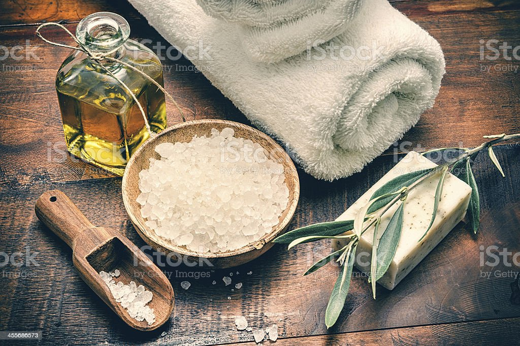 Spa setting with natural olive soap and sea salt stock photo