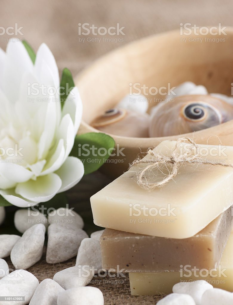 Spa setting with natural soaps and lotus flower. royalty-free stock photo