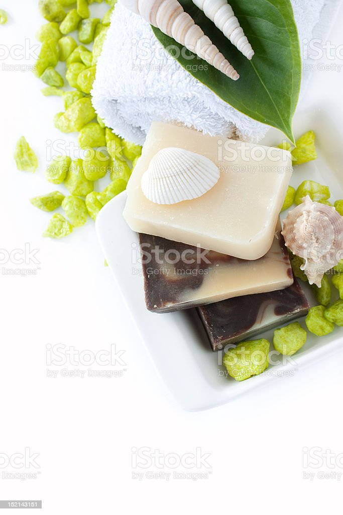 Spa setting with natural soaps and shampoo royalty-free stock photo