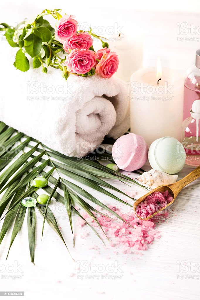 Spa setting with pink roses and aroma oil, vintage style stock photo