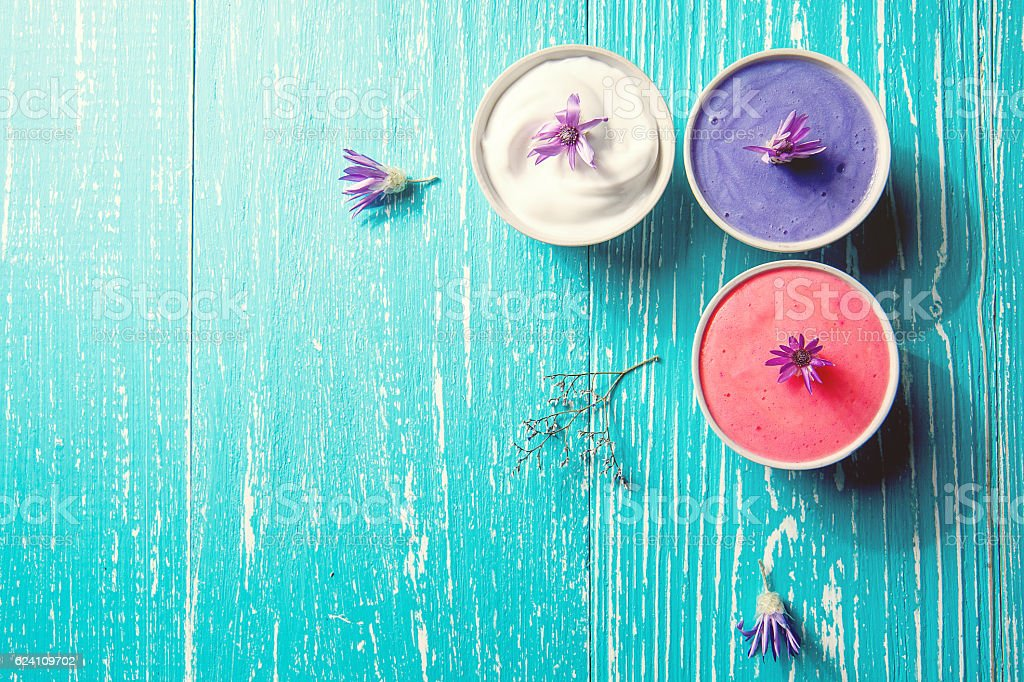 spa setting with purple flower on blue wooden background stock photo