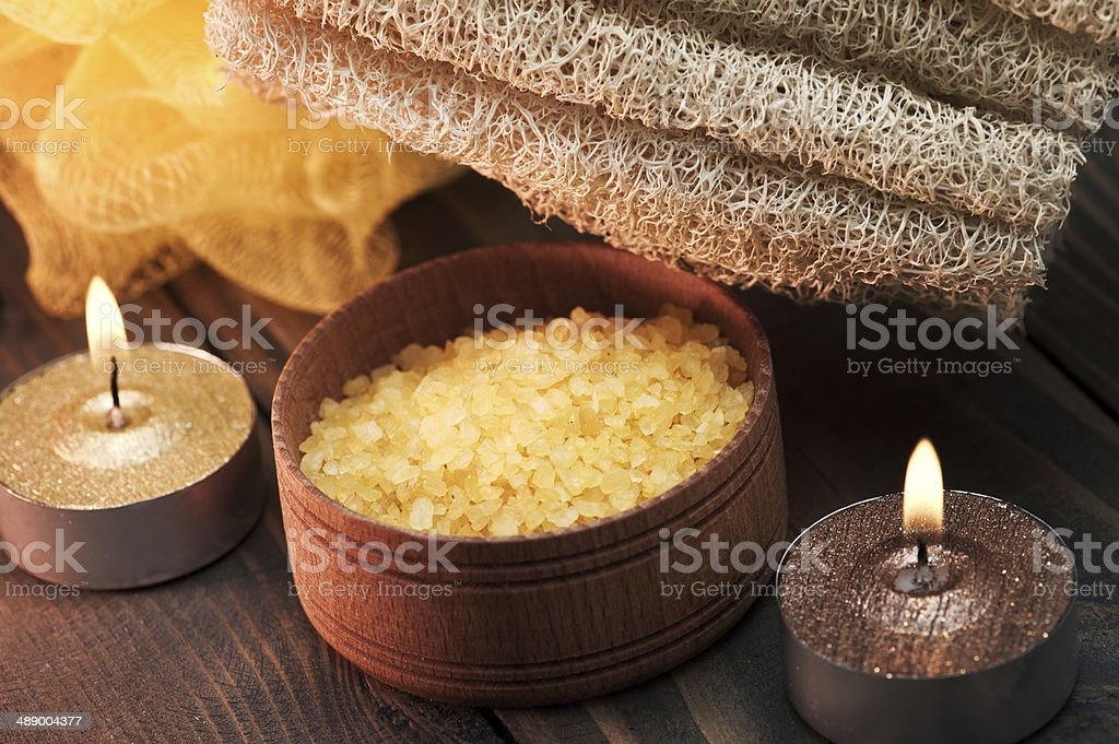 Spa setting with solt and candles on wooden background stock photo