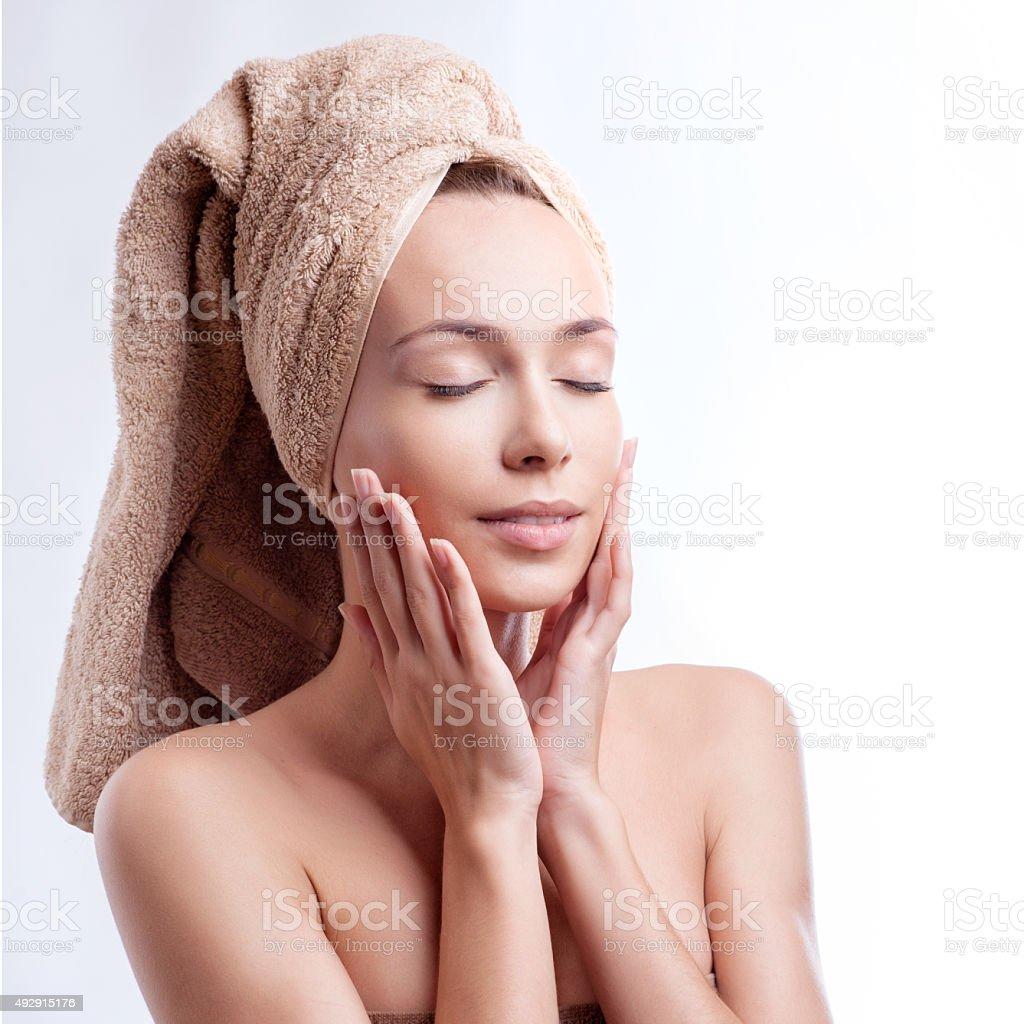 Spa skin care beauty woman wearing hair towel stock photo