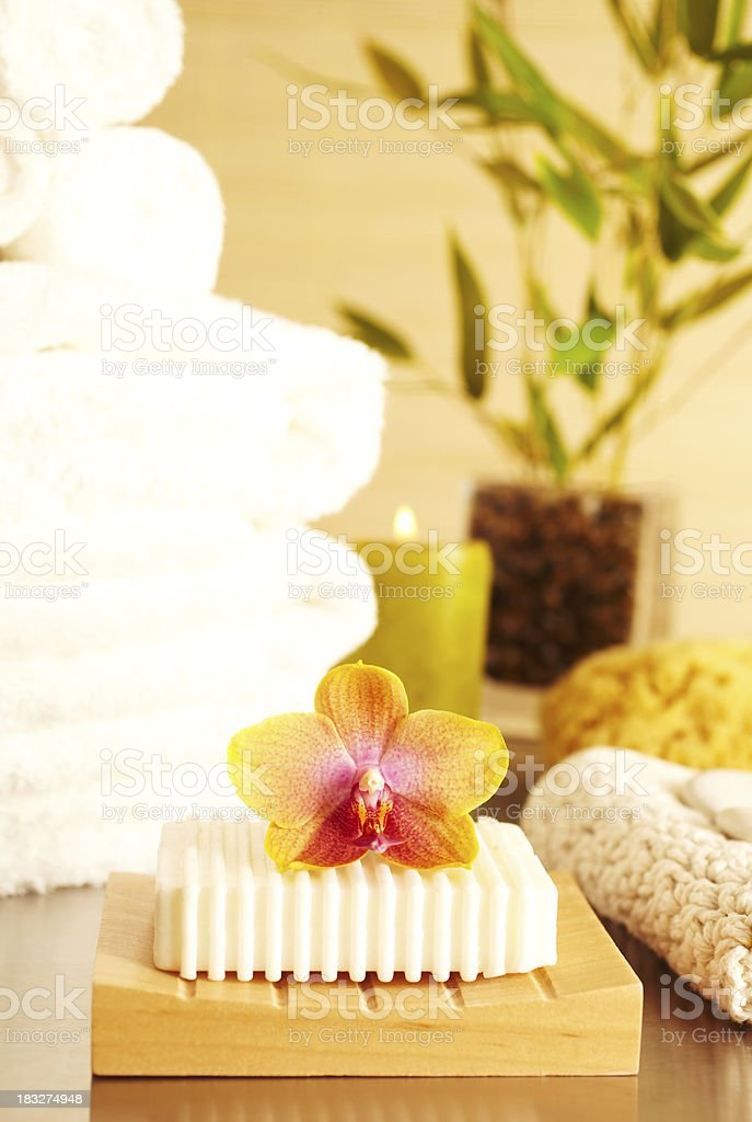 Spa still life bar of soap and flower in bathroom royalty-free stock photo
