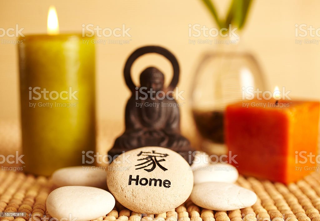 Spa still life buddha statue and candles, home pebble stock photo