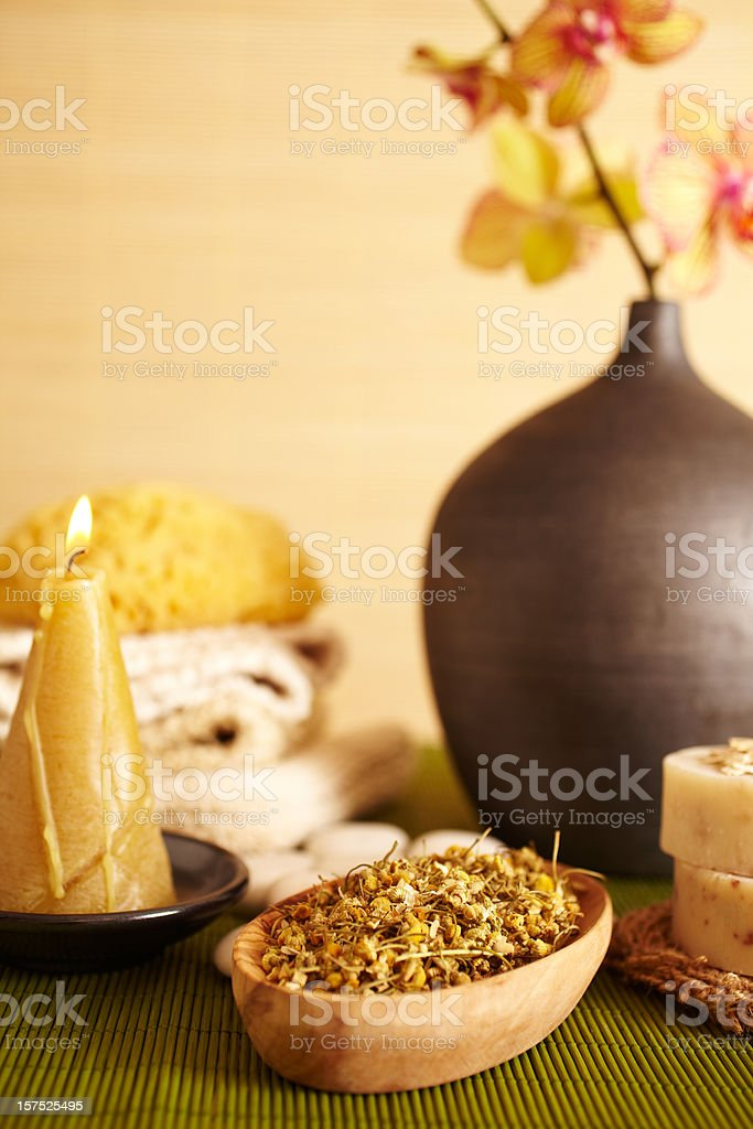 Spa still life chamomile herbs in a wooden bowl stock photo
