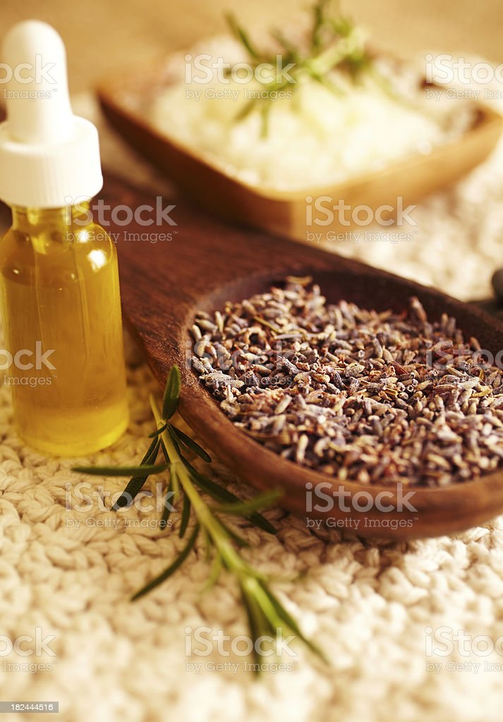 Spa still life lavender in wooden spoon with massage oil royalty-free stock photo