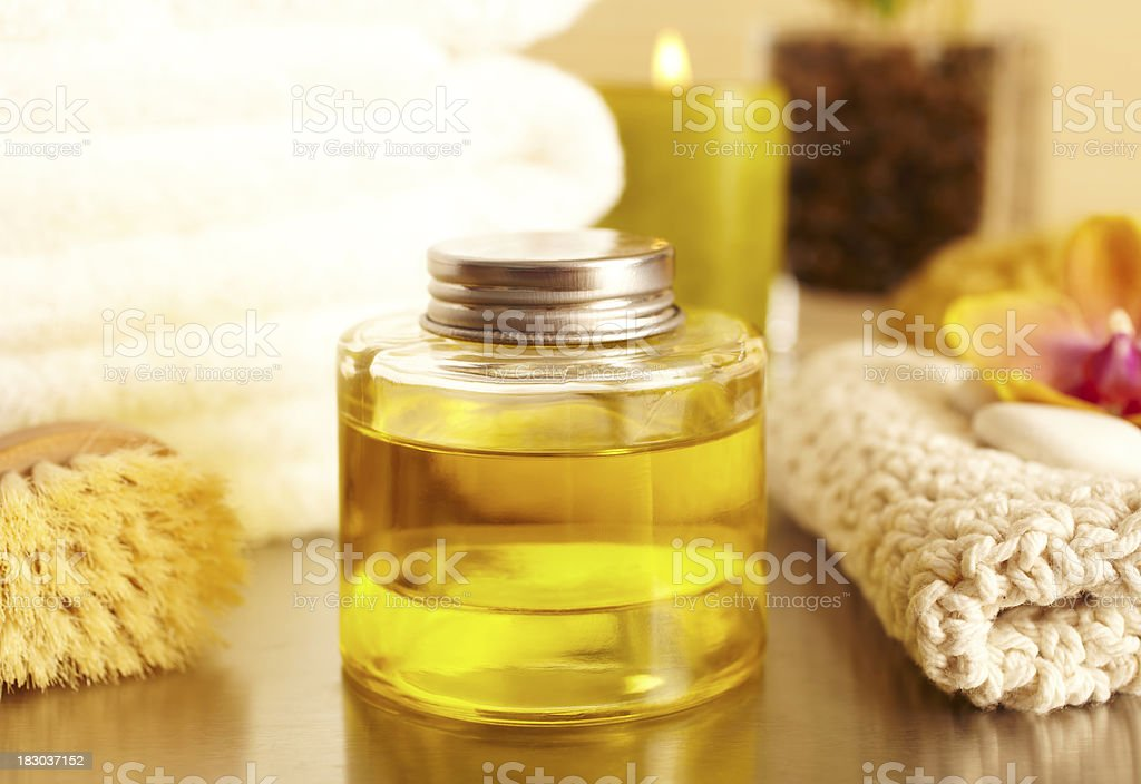 Spa still life of bottle with essential oil in bathroom royalty-free stock photo