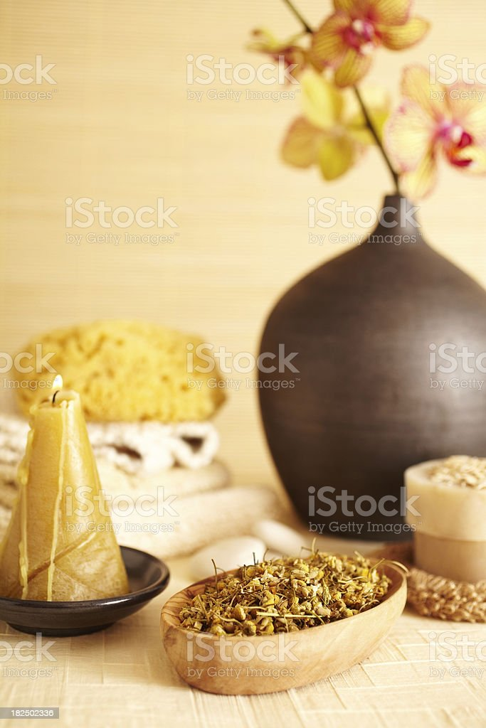Spa still life of Camomile flowers and candle in bathroom stock photo