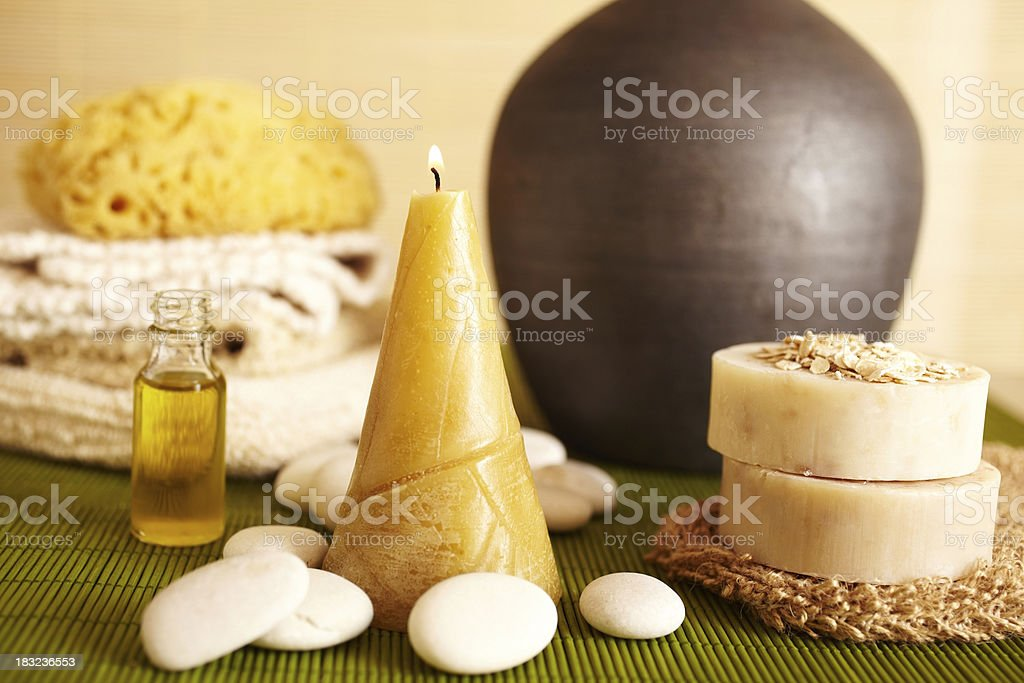 Spa still life of candle, massage oil and soap stock photo