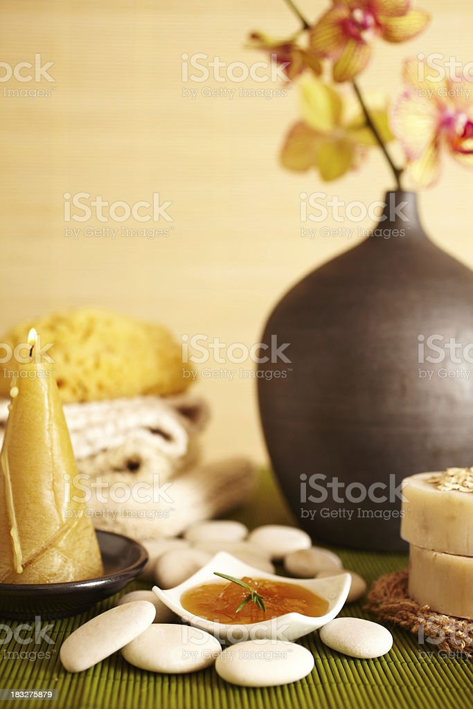 Spa still life of honey and orchid in bathroom royalty-free stock photo